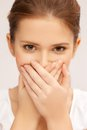 Face of beautiful teenage girl covering her mouth speak no evil concept Royalty Free Stock Photo
