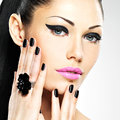 Face of the beautiful woman with black nails and pink lips sexy sexy girl fashion makeup Royalty Free Stock Photos