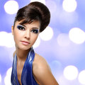 Face of beautiful woman with fashion hairstyle and glamour makeu makeup over creative soft bokeh background Royalty Free Stock Image