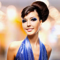 Face of beautiful woman with fashion hairstyle and glamour makeu makeup over creative soft bokeh background Royalty Free Stock Photos