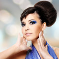 Face of beautiful woman with fashion hairstyle and glamour makeu makeup over creative soft bokeh background Royalty Free Stock Photo