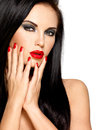 Face of a beautiful woman with red nails and lips closeup brunette isolated on white background Stock Photography