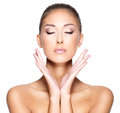 Face of a beautiful young woman with healthy skin portrait clear that wants to touch her both hands Stock Photo