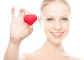 Face of a beautiful young woman with red heart symbol love Stock Photos