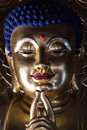 Face of buddha statue golden in beijing china Stock Images