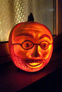 Face carved in pumpkin shines a a pumkin Stock Images