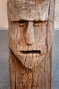 Face carved in the trunk of a tree representation of elemental creature Stock Photo