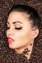 Face with closed eyes in the coffee beans woman Stock Image