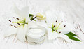 Face cream with lily flowers Royalty Free Stock Photo
