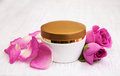 Face cream with pink roses Royalty Free Stock Photo