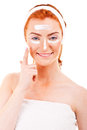 Face cream woman applying skin cream under eyes over white background Stock Images