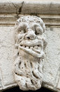 Face of devil head relief on a facade a medieval house venice italy Royalty Free Stock Photos