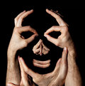 Face hands concept. Realty manipulation illusion. Black background Royalty Free Stock Photo