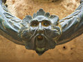 Face on iron ring alhambra spain Stock Photography