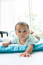 Face of little baby lying on children bed in home living room Royalty Free Stock Photo