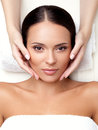 Face massage close up of a young woman getting spa treatment Royalty Free Stock Photos