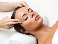 Face massage close up of a young woman getting spa treatment Stock Images