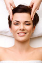 Face massage close up of a young woman getting treatment in spa salon Royalty Free Stock Image