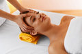 Face massage. Face treatment, skin care, wellbeing, wellness con Royalty Free Stock Photo