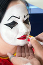 Face paint for pierrot clown woman getting her painted Royalty Free Stock Photography
