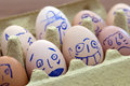 Face painted eggs Royalty Free Stock Photo