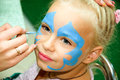 Face painting beautiful girl with blue eyes with painted butterfly on her Royalty Free Stock Photo