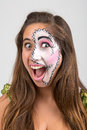 Face painting beautiful young girl with Stock Images