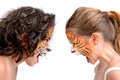 Face painting felines beautiful young girls with feline painted faces tiger and leopard Royalty Free Stock Photo