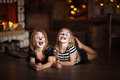 Face painting girls cats dark background, concept of holiday dar Royalty Free Stock Photo