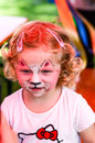 Face painting small girl with painted Stock Photo