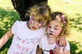 Face painting two small girls with painted Royalty Free Stock Photos