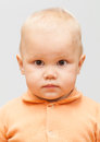 Face portrait of caucasian baby girl closeup studio on gray background Royalty Free Stock Photography