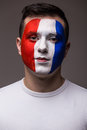 Face portrait of Pray France football fan in game  of France national  team look at camera. Royalty Free Stock Photo
