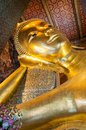 Face of Reclining Buddha gold statue in Wat Pho buddhist temple Royalty Free Stock Photo