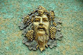 Face relief sculpture on retro concrete wall Royalty Free Stock Photo