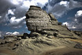 Face rock this symbol called sfinx is a shaped by wind and other natural phenomenon it is located in bucegi mountains some Stock Photography