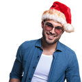Face of a smiling young casual santa man looking at the camera on white background Stock Image