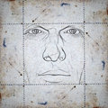 Face on stained paper Royalty Free Stock Photo