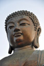 The face of tian tan giant buddha from po lin monastery on lantau island hong kong china Stock Photos