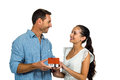 Face to face couple holding house model Royalty Free Stock Photo
