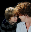 Face to face mother and teenager son Stock Images