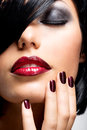 Face of a woman with beautiful dark nails and sexy red lips fashion model black shot hairs at studio Royalty Free Stock Photos