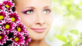 Face of woman with chrysanthemum Stock Photos
