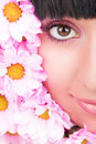 Face of the woman and flowers Stock Image