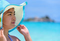 Face woman is happy with the sea in thailand young wearing sun protection hat to see beautiful nature of and beach under summer Royalty Free Stock Photos