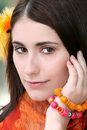 Face of a Woman with Orange Accessories Royalty Free Stock Photo