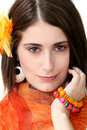 Face of a Woman with Orange Accessories Stock Photo