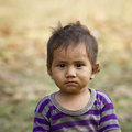Face of a young kid in népal looking at us portrait nepal Stock Images