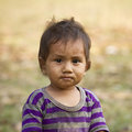 Face of a young kid in népal yound nepali looking at us nepal bardia Stock Photo