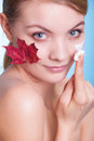 Face of young woman girl with red maple leaf cream skincare habits as symbol capillary skin on blue taking care her dry complexion Royalty Free Stock Photo